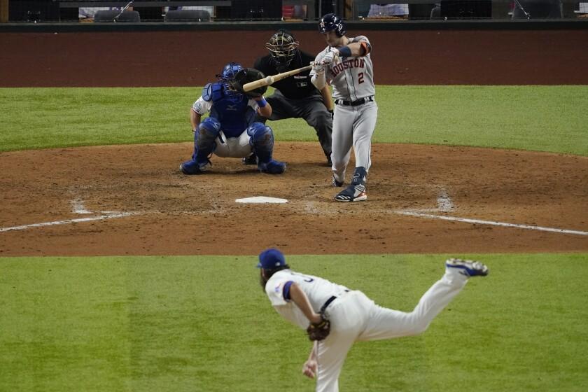 Houston Astros' Alex Bregman hits a double off Texas Rangers starting pitcher Lance Lynn during the sixth inning of a baseball game in Arlington, Texas, Thursday, Sept. 24, 2020. (AP Photo/Tony Gutierrez)
