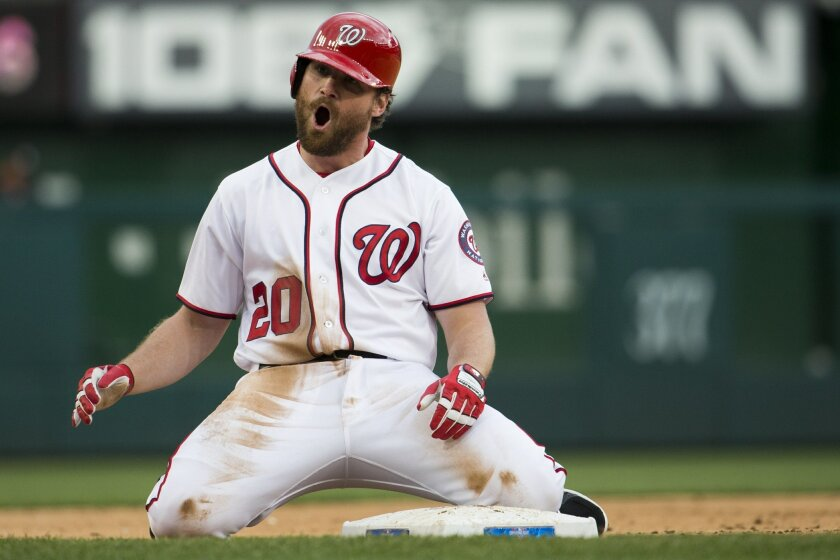 FILE - In this April 7, 2016, file photo, Washington Nationals Daniel Murphy screams after hitting a three-run triple during the first inning of a baseball game against the Miami Marlins at Nationals Park  in Washington. Murphy is off to the hottest start of his career, batting almost .400, and the