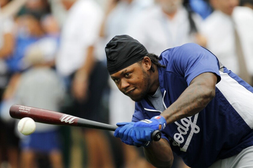 Los Angeles Dodgers' Hanley Ramirez hits the ball while waiting his turn at batting practice before a game against Kansas City Royals on June 23.