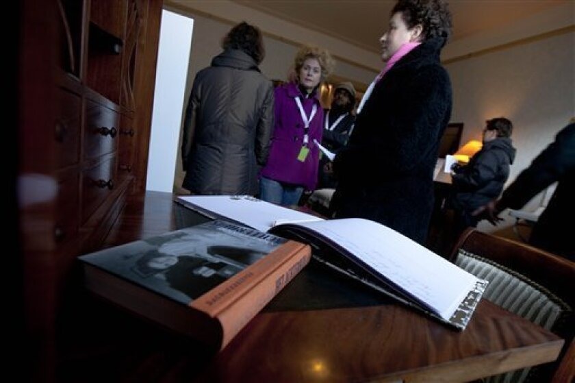 FILE - In this Saturday Dec. 10, 2011 file photo Anne Frank's diary is seen on her writing desk as visitors tour the first house of Anne Frank in Amsterdam, Netherlands, where the Frank family lived from 1933 to 1942 before going into hiding into The Secret Annex. Two nonprofit organizations, The A