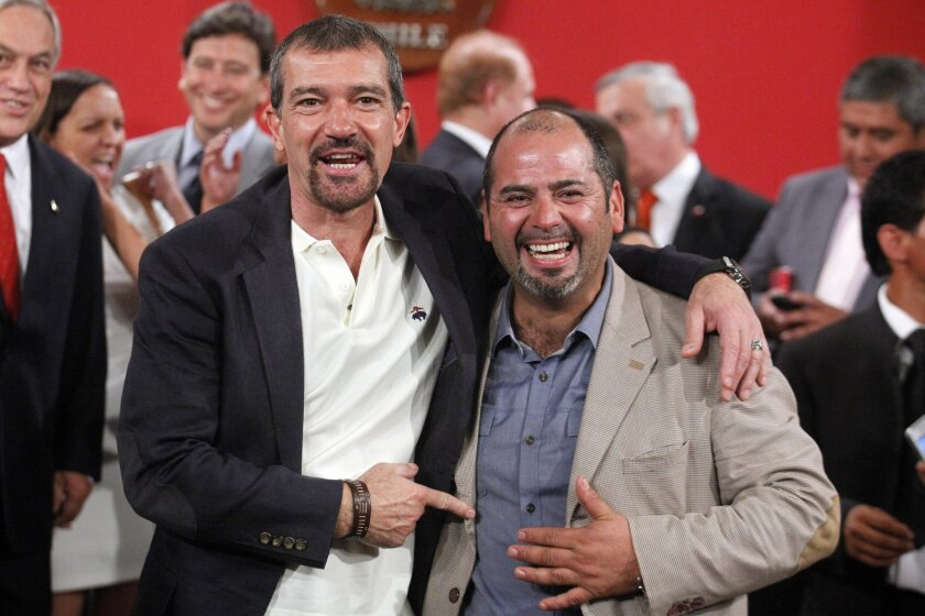 """The Spanish actor, Antonio Banderas, left, poses for photographers next to Mario Sepulveda, in Santiago, Chile, Friday Jan. 31, 2014. Sepulveda was one of the 33 miners who was trapped in a mine cave-in in Chile's Atacama desert in 2010. The Spanish star will play Sepulveda, who known as """"Super Mar"""
