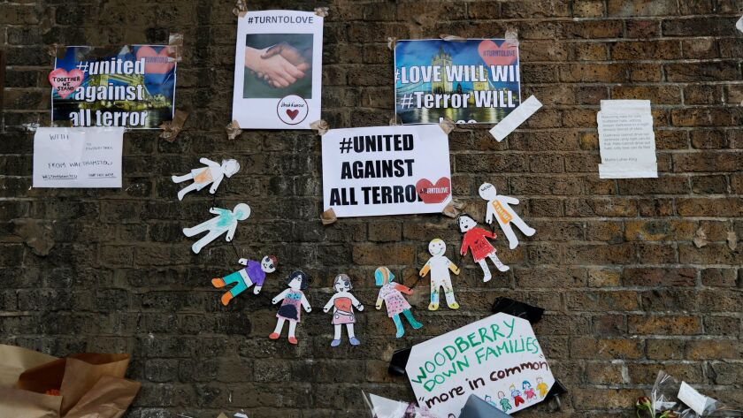 Unity messages are displayed on June 20, 2017, near the scene of a van attack in the Finsbury Park a