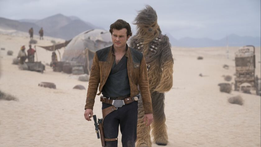 FILE - This undated file image released by Lucasfilm shows Alden Ehrenreich and Joonas Suotamo in a