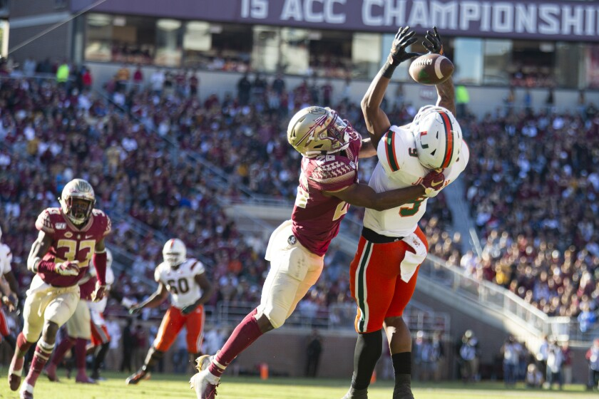 Florida State defensive back Asante Samuel Jr. (26) breaks up a pass intended for Miami tight end Brevin Jordan.