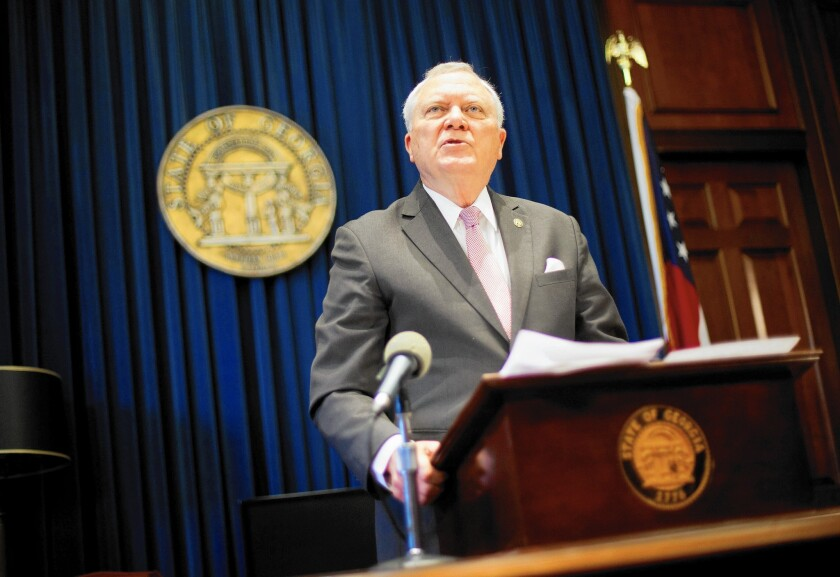 """Georgia Gov. Nathan Deal talks to reporters Monday after he vetoed a """"religious liberty"""" bill criticized as being anti-gay."""