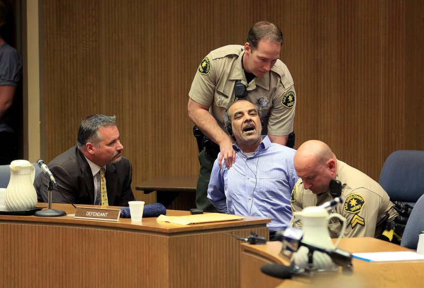 Murder suspect Kassim Alhimidi reacts to being found guilty in William J. McGrath's courtroom for the murder of his wife Shaima Alawadi. As the verdict was read the victim's mother and the defendant's son yelled in court and he was dragged from court. Defense attorney Richard Berkon sits at left.