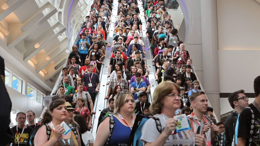 Comic-Con attendees pack the escalators at the San Diego Convention Center in this file photo. Even after the coronavirus is much less of a threat, millions of people will continue to fear crowds and change their behavior as consumers as a result.