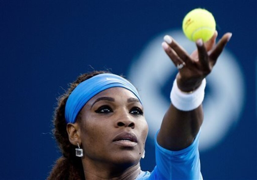 Serena Williams, of the United States, serves the ball to Agnieszka Radwanska, of Poland, during a semifinal of the Rogers Cup women's tennis tournament in Toronto on Saturday, Aug. 10, 2013. (AP Photo/The Canadian Press, Nathan Denette)