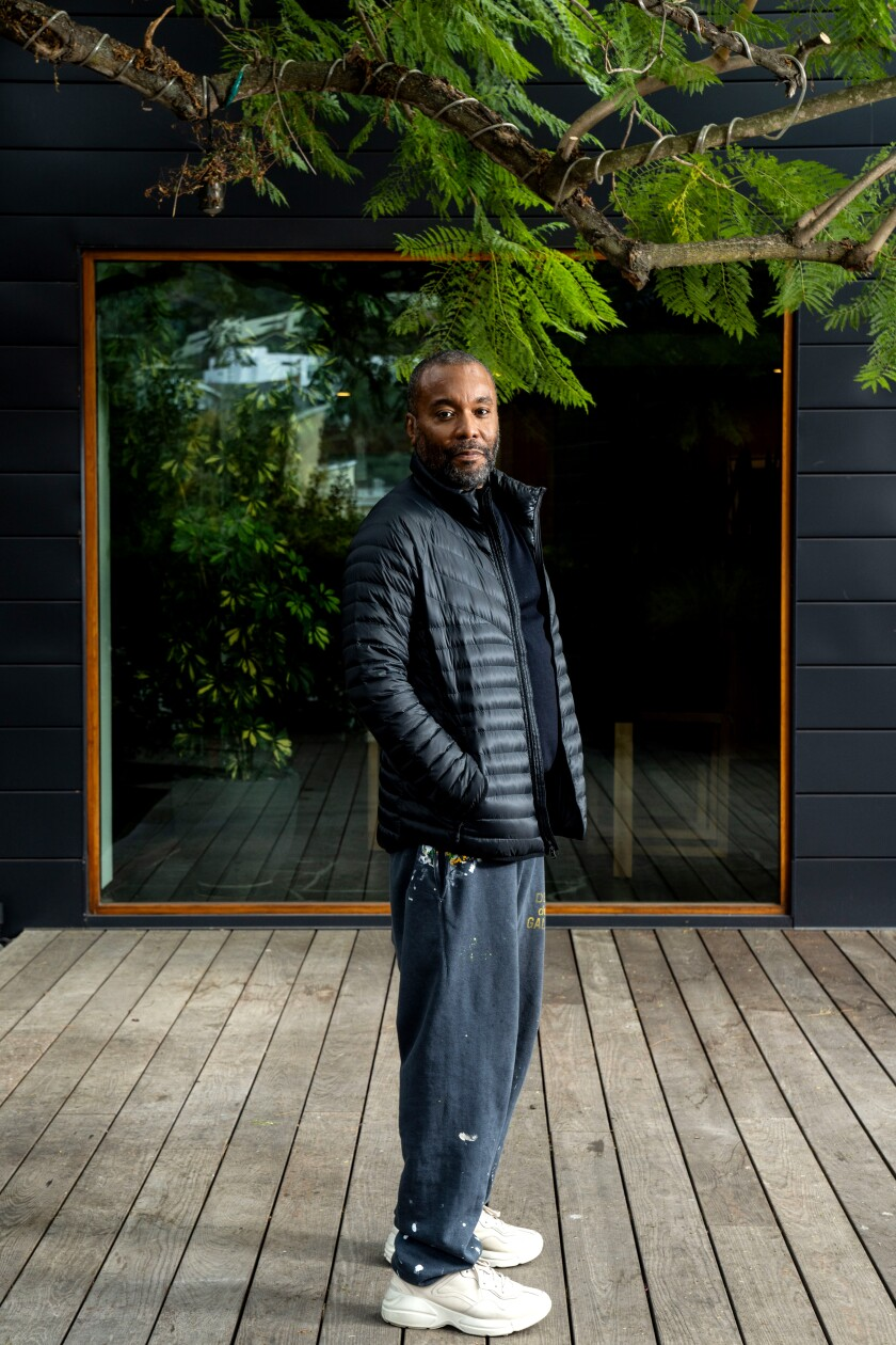 Director Lee Daniels in a puffy coat and sweatpants standing on his deck