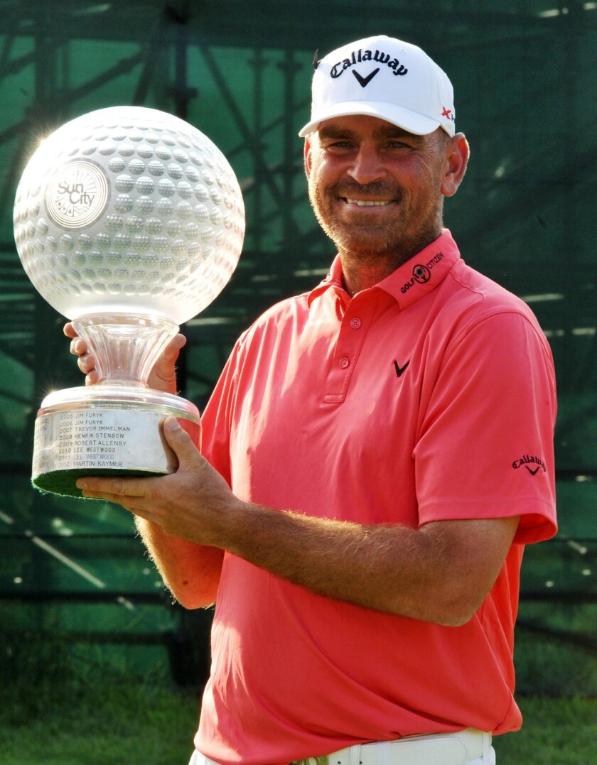 Denmark's Thomas Bjorn with the trophy after winning the Nedbank Golf Challenge at Sun City South Africa, Sunday, Dec 8, 2013. (AP Photo)