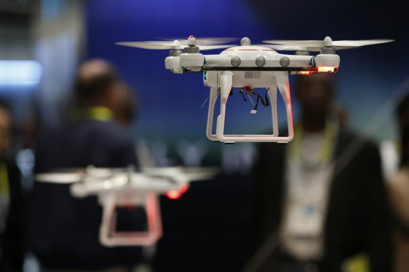 Drones fly at the Autel booth during the International CES Wednesday, Jan. 7, 2015, in Las Vegas. (AP Photo/John Locher)