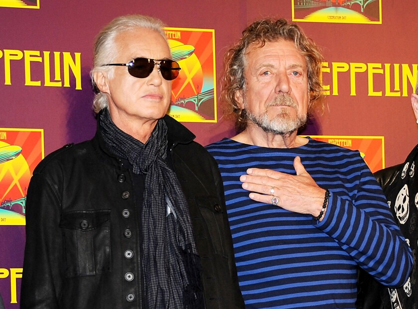 """In this Oct. 9, 2012, file photo, Led Zeppelin guitarist Jimmy Page, left, and singer Robert Plant appear at a news conference. A federal judge in Los Angeles ruled Friday, April 8, 2016, that a copyright infringement lawsuit over the song """"Stairway to Heaven"""" should be decided at trial."""