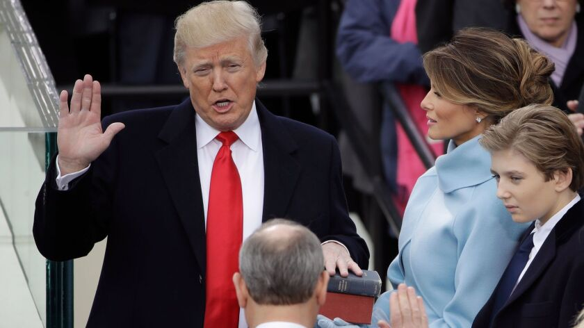 Donald Trump is sworn in as the 45th president of the United States by Chief Justice John Roberts as