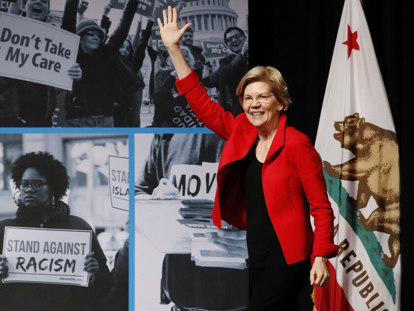 Sen. Elizabeth Warren, shown at a San Francisco forum in June, now leads the Democratic presidential race in California, according to a new poll.