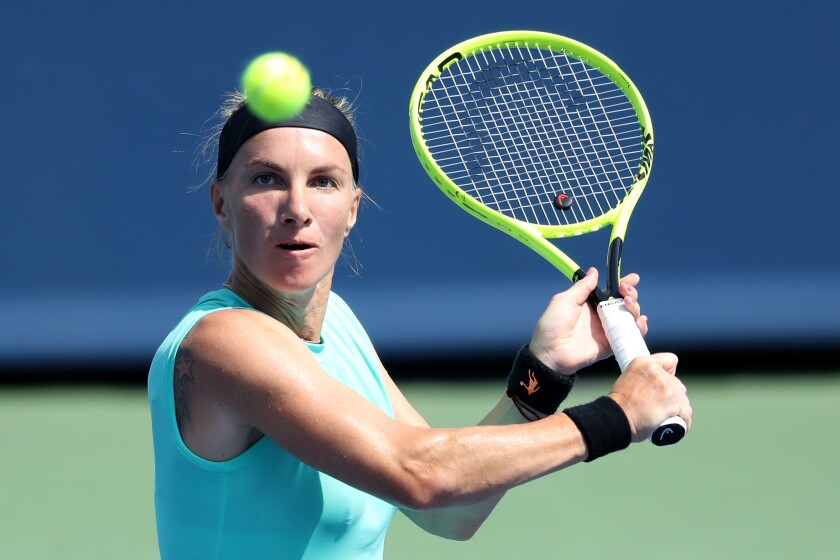 MASON, OHIO - AUGUST 17: Svetlana Kuznetsova of Russia returns a shot to Ashleigh Barty of Australia during Day 8 of the Western and Southern Open at Lindner Family Tennis Center on August 17, 2019 in Mason, Ohio. (Photo by Rob Carr/Getty Images) ** OUTS - ELSENT, FPG, CM - OUTS * NM, PH, VA if sourced by CT, LA or MoD **