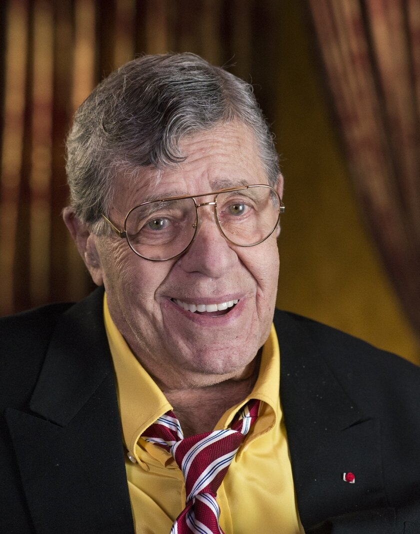 """This April 14, 2014 photo shows actorr and comedian Jerry Lewis during an interview at TCL Chinese Theatre in Los Angeles. After nearly 70 years in show business, Lewis continues to do standup and serve as leader of the storied Friars Club. On Thursday, he'll host a dinner at the venerable comedy institution to celebrate the 50th anniversary of his film """"The Nutty Professor."""" (Photo by Dan Steinberg/Invision/AP)"""