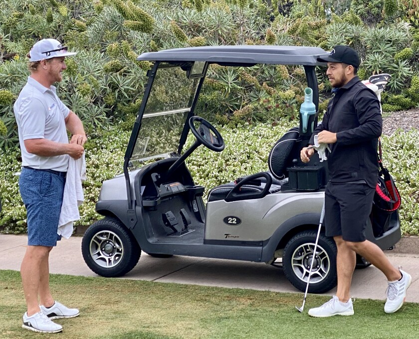 PGA Tour players Charley Hoffman, a Poway native, and San Diegan Xander Schauffele (right) prepare to play in a fundraiser to benefit employees at Fairmont Grand Del Mar on Monday.