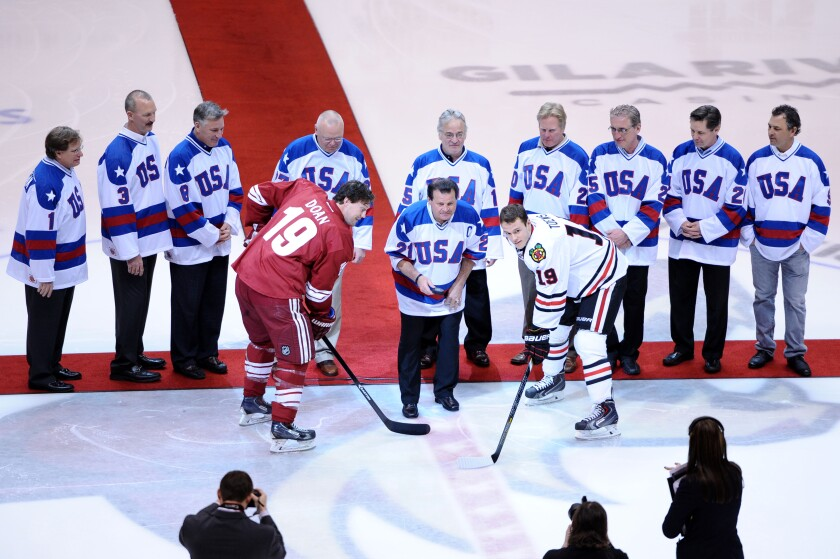 Mike Eruzione drops the puck before a game between the Coyotes and the Blackhawks on Feb. 7, 2014 at Gila River Arena.