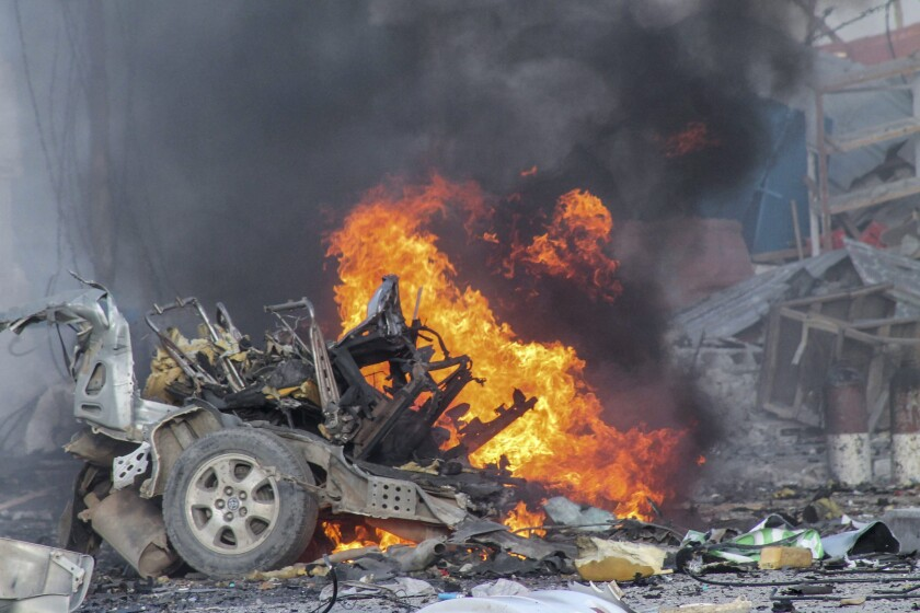 A vehicle burns after a car bomb exploded in front of the Sahafi Hotel in Mogadishu, Somalia, on Nov. 1.