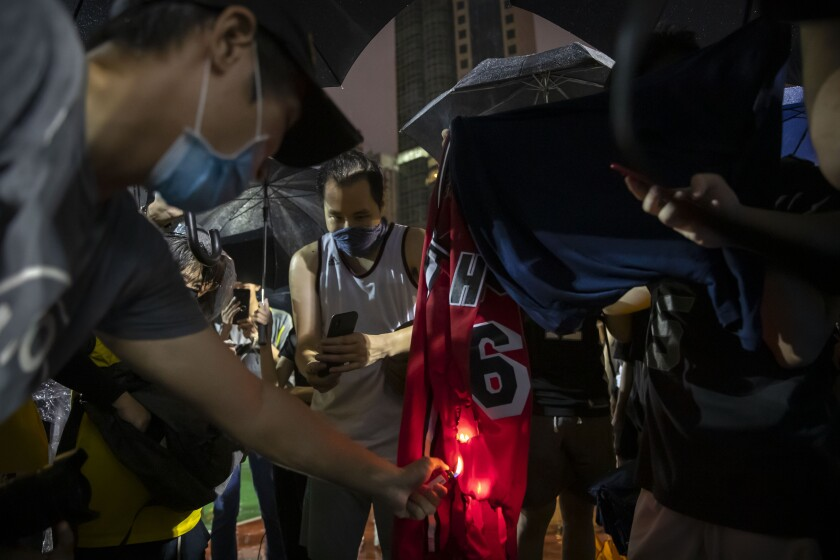Demonstrators in Hong Kong set a LeBron James jersey on fire.