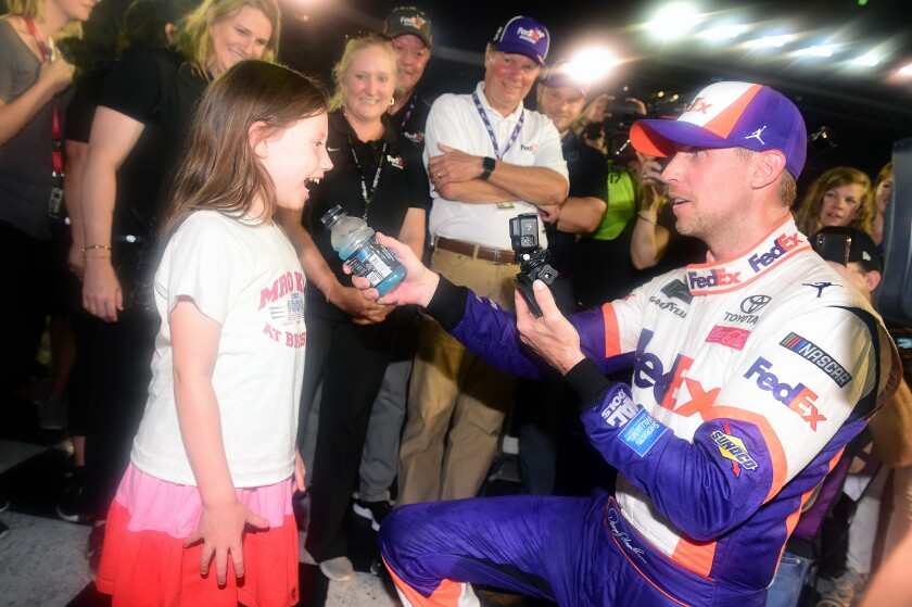 Denny Hamlin celebrates with his daughter, Taylor, in Victory Lane after winning the NASCAR Cup Series race at Bristol Motor Speedway on Aug. 17.