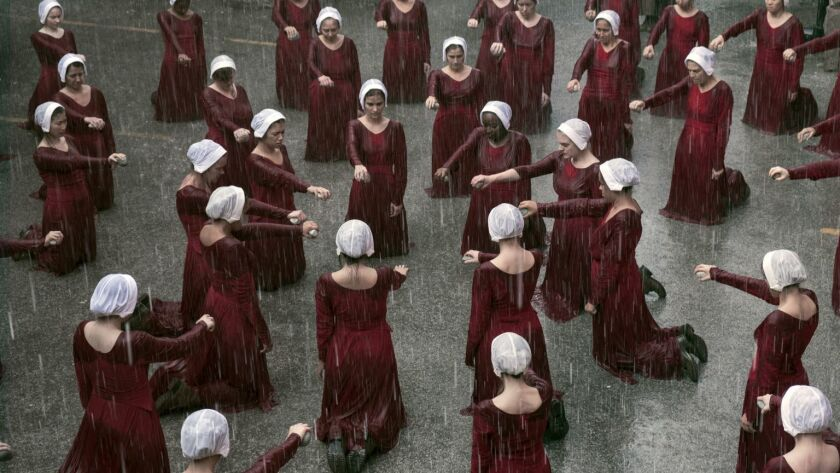 "This image released by Hulu shows a scene from the series, ""The Handmaid's Tale,"" returning for a se"