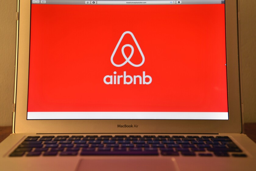 The Airbnb logo is displayed on a computer screen on Aug. 3, 2016.