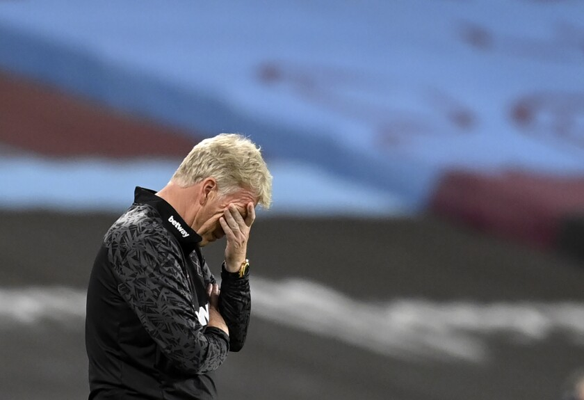 West Ham's manager David Moyes reacts during the English Premier League soccer match between West Ham United and Newcastle United at the London Stadium in London, Saturday, Sept. 12, 2020. (Michael Regan/Pool via AP)