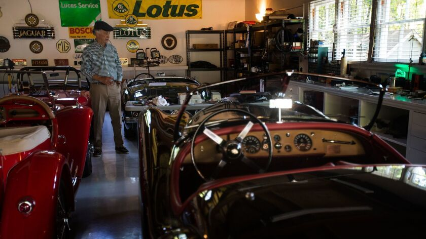 Creighton Turner, among his vintage MGs, Jaguars and Austin-Healeys, stands in the Pasadena garage where he co-founded Car Night more than 35 years ago.