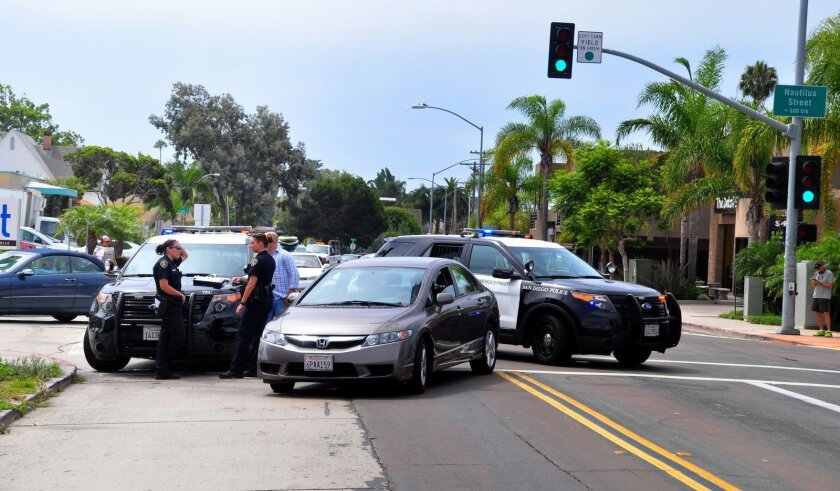 Police close off La Jolla Boulevard at Nautilus Street the morning of July 30, after a motorist struck a pedestrian in the crosswalk.