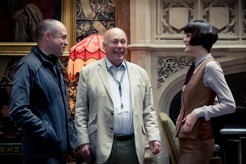 """""""Downton Abbey"""" producer Gareth Neame, writer-producer Julian Fellowes and actress Michelle Dockery on the set of the """"Downton Abbey"""" movie."""