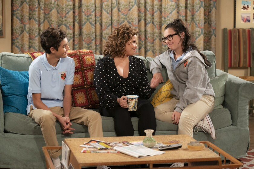 """Marcel Ruiz as Alex, Justina Machado as Penelope and Isabella Gomez as Elena in """"One Day at a Time."""""""