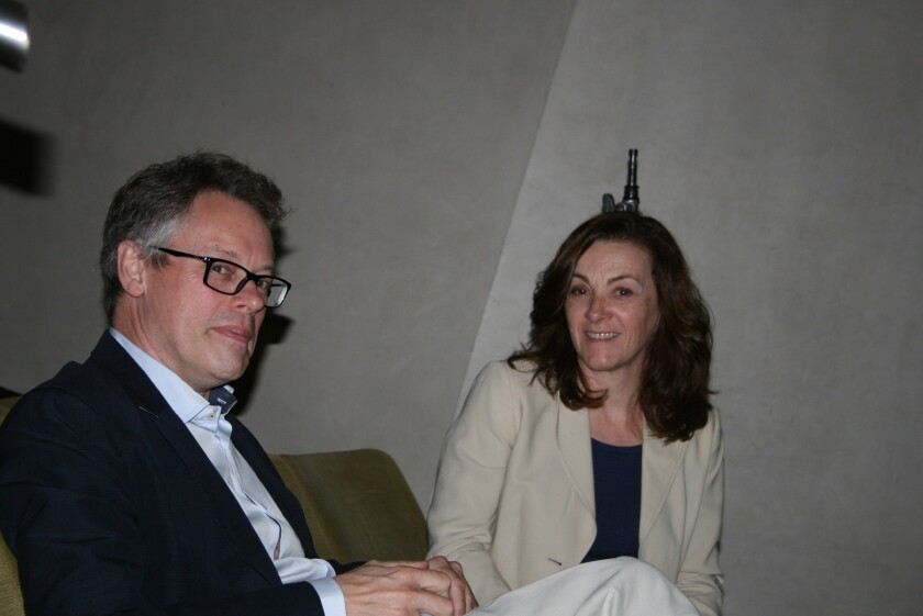Sir Dermot Turing chats with Joanna Davies of The Biomedical Research Institute in La Jolla before the presentation.