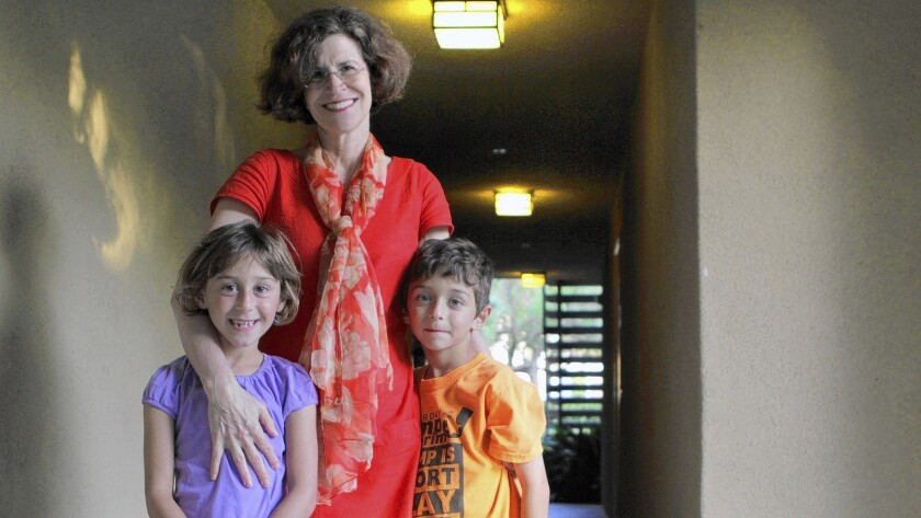 Wendy Wolfson of Irvine, mother of 7-year-old twins, got help with child care through an employee assistance program.