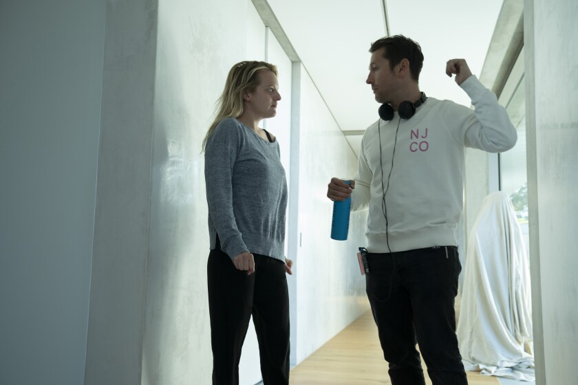 "Elisabeth Moss and writer-director Leigh Whannell on the set of ""The Invisible Man"" movie."