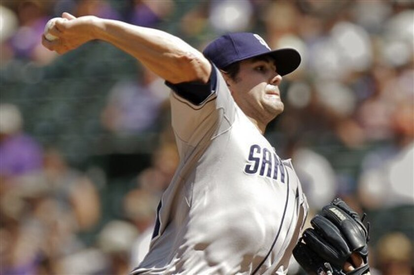 San Diego Padres starting pitcher Casey Kelly challenges Colorado Rockies' Dexter Fowler during the first inning of a baseball game, Sunday, Sept. 2, 2012, in Denver. (AP Photo/Barry Gutierrez)