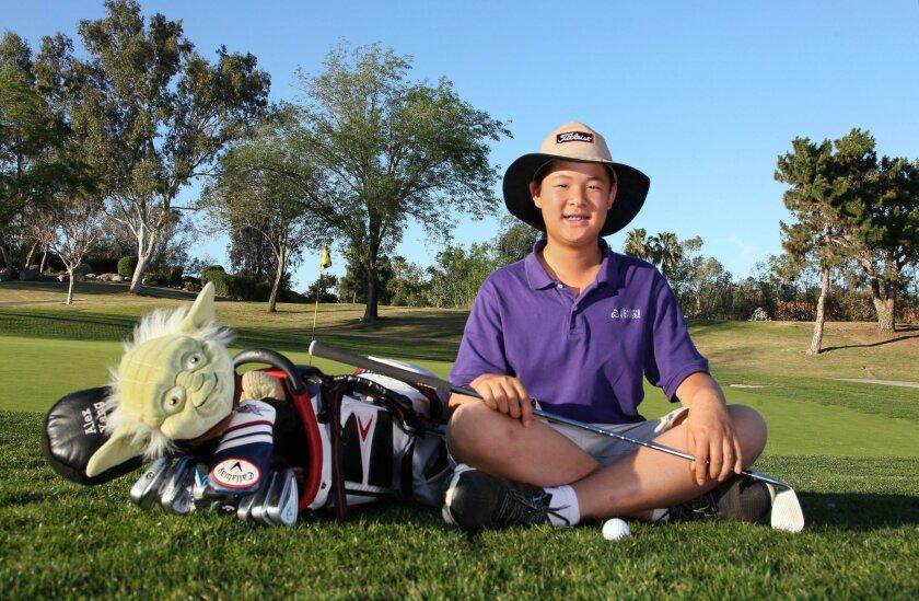 Portrait of golfer Alexander Yang, 13, at the Shadowridge Country Club.