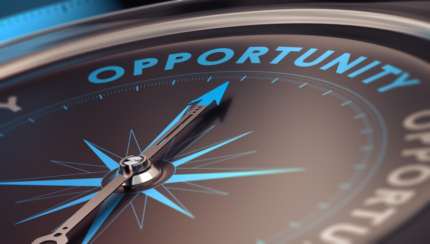 Compass with needle pointing to the word opportunity.