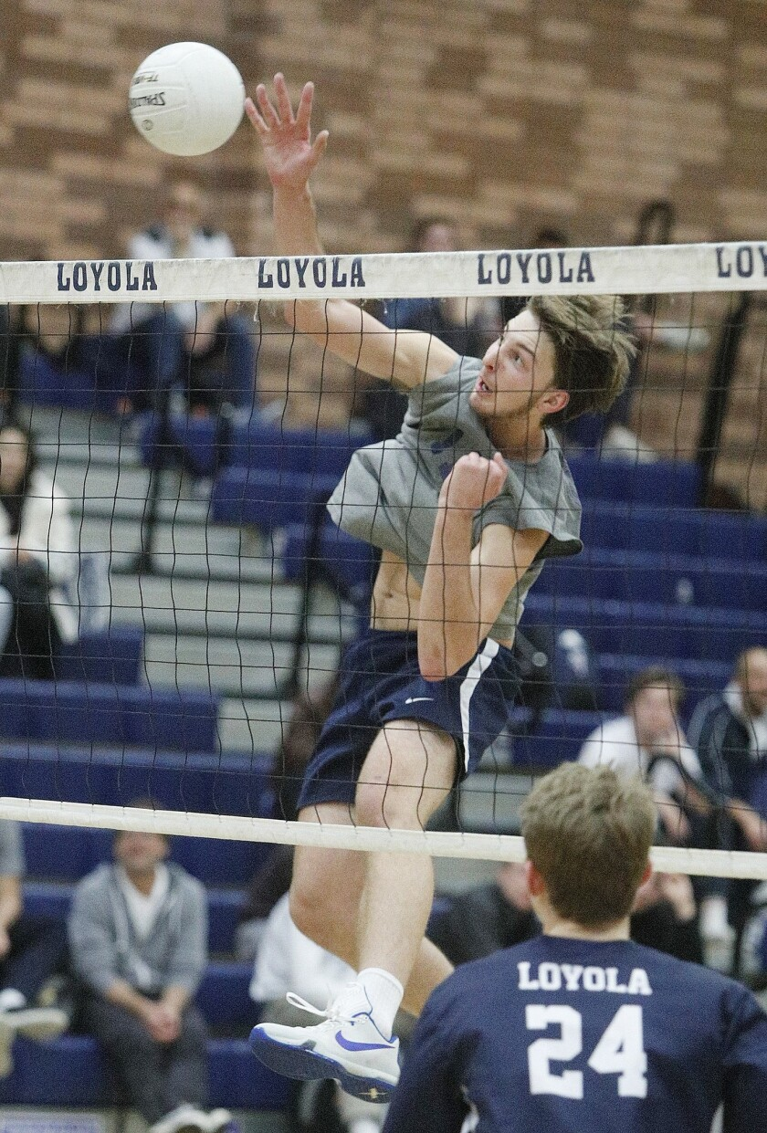 Corona del Mar's Glen Linden hits a kill against Loyola in a nonleague boys' volleyball match at Loy