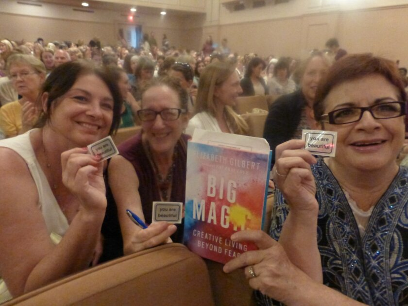 "Gilbert's fans show off badges that read ""You are beautiful."" Courtesy photo"
