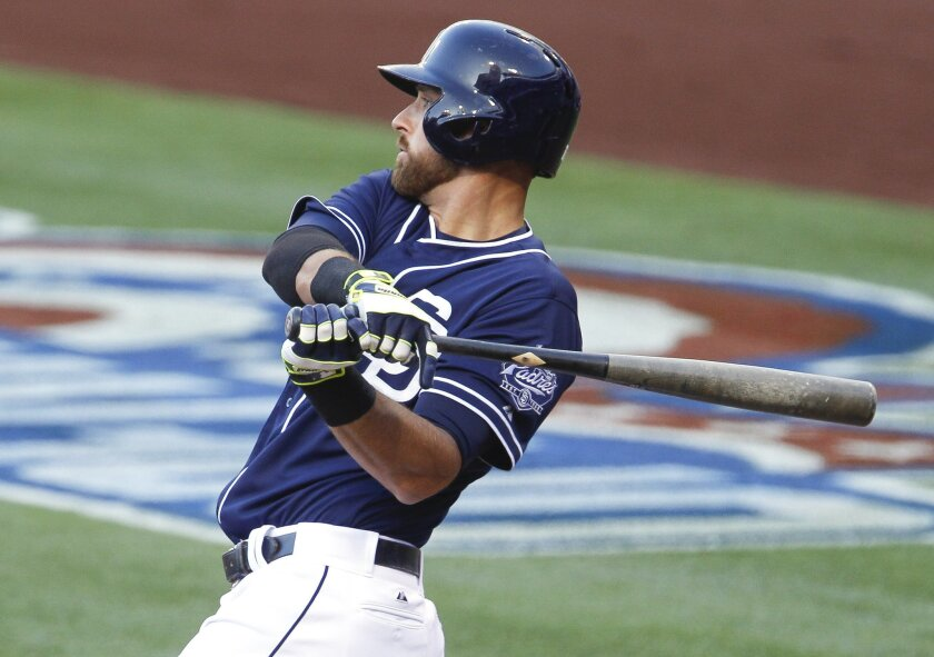 The Padres' Will Middlebrooks hits an RBI single in the first inning.