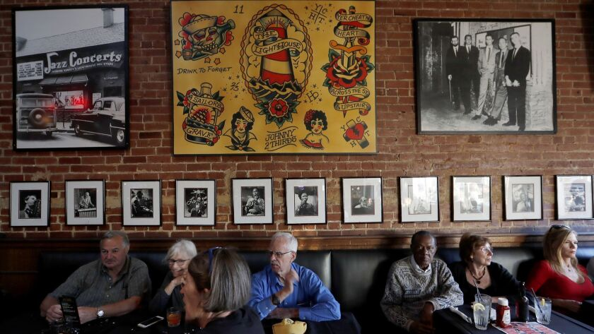 Patrons fill the tables inside the Lighthouse Cafe on June 26 for a birthday gathering.