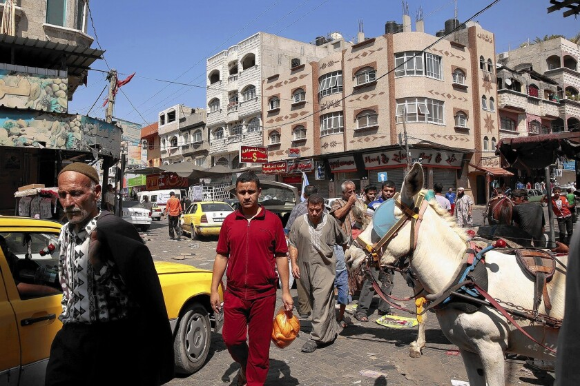 Palestinians head to the market in Jabaliya, in the Gaza Strip, to prepare for the meal to break the daily fast on the last night of Ramadan, the Muslim fasting month.