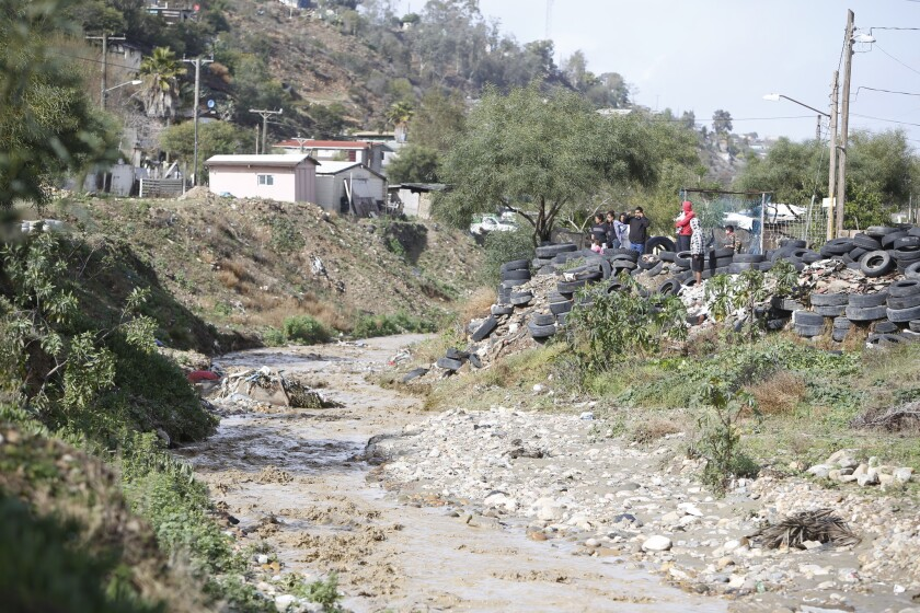 The Tijuana River is often polluted with old tires, plastic bags, discarded food and other debris.
