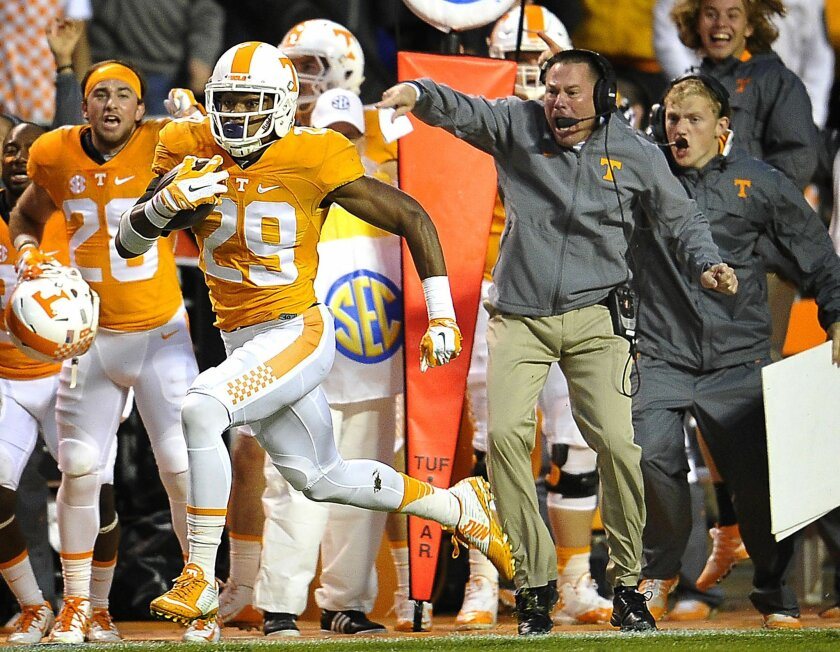 FILE - In this Oct. 3, 2015, file photo Tennessee head coach Butch Jones cheers on Evan Berry (29) as he returns a kickoff for a touchdown during the first half of an NCCAA College football game against Arkansas, in Knoxville, Tenn. As the nation's leading kickoff returner, the younger brother of K