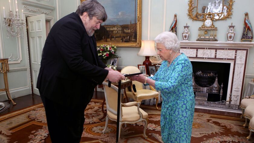Queen Elizabeth II presents Oliver Knussen with the Queen's Medal for Music during an audience at Buckingham Palace in 2016