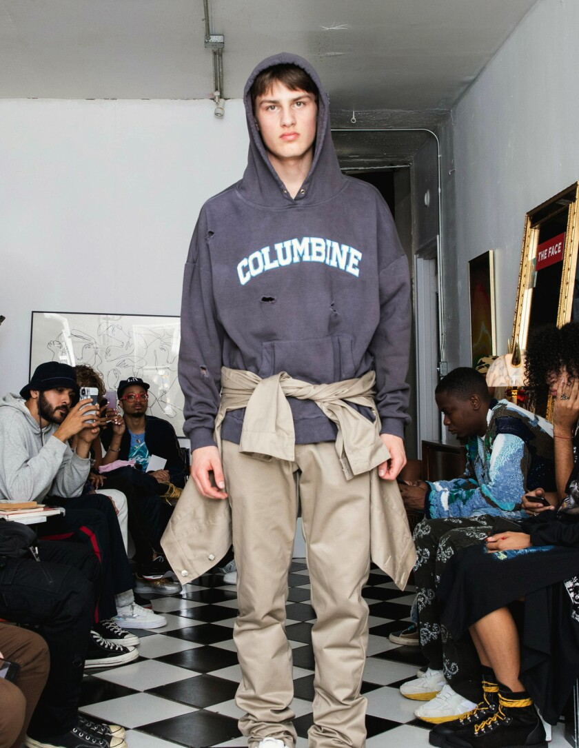 In this Friday, Sept. 13, 2019 photo provided by Bstroy, models at a show for fashion brand Bstroy wear hoodies emblazoned with the names of schools touched by mass shootings, at an apartment in the Soho neighborhood of Manhattan in New York. The hoodies have created a backlash from critics who say they glamorize violence and aim to profit from tragedy. Bstroy co-founder Dieter Grams says the hoodies are an effort to bring attention to gun violence and are not for retail sale. (Bstroy via AP)