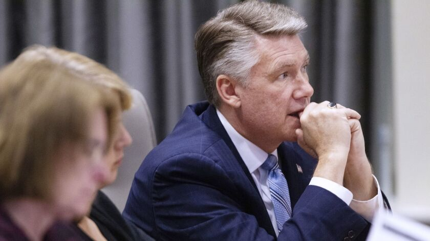 At the North Carolina State Bar in Raleigh, N.C., Mark Harris, Republican candidate in North Carolina's 9th Congressional District race, listens on Feb. 20, 2019, to testimony during the third day of a public evidentiary hearing on voting irregularities.