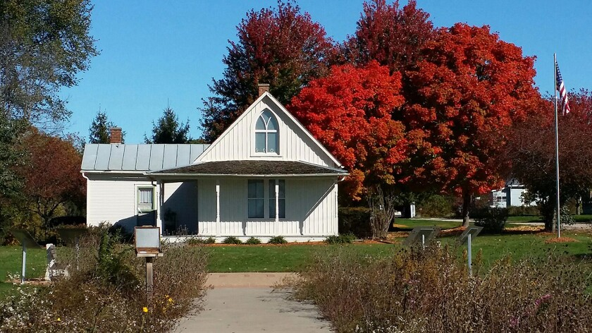 """The house in Eldon, Iowa, that inspired Grant Wood's """"American Gothic"""" draws thousands of visitors a year, but they rarely stick around to see the town."""