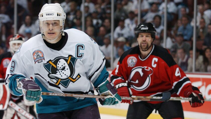 Paul Kariya (9), the Anaheim Mighty Ducks very first draft pick, skates against the New Jersey Devils in game three of the 2003 Stanley Cup Finals.